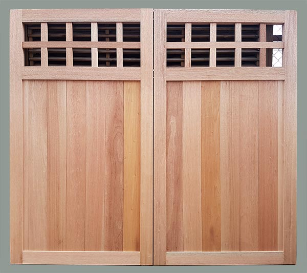 Meranti double boarded garage door with glass panels
